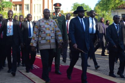 President Salva Kiir, right, wearing hat,  and Riek Machar, left (file photo).