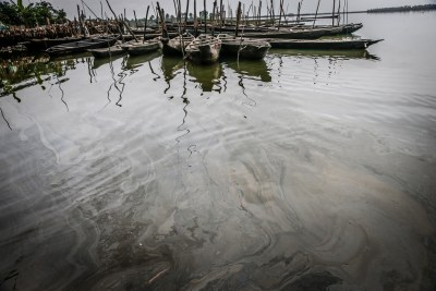 Fishing boats on polluted water in Bodo