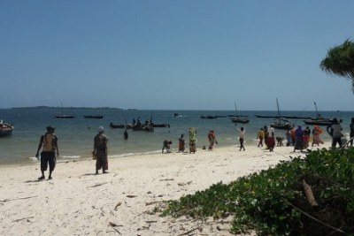 People at Gasi Beach in Kwale County, on Kenya's Indian Ocean coast, wait for fishermen to buy the daily catch (file photo).