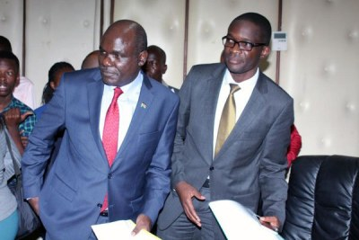 Independent Electoral and Boundaries Commission chairperson Wafula Chebukati (left) and CEO Ezra Chiloba after the press conference in Nairobi on February 21, 2017.
