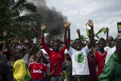 Protesters raise their hands in front of police in a protest in Bujumbura. (file photo)