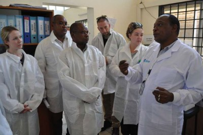 Kilifi County Hospital Laboratory officer Raphael Nella, right, explains how the facility operates to Governor Amason Kingi, centre, and visiting officials from the US congress on October 27, 2016. The officials were inspecting projects funded by World Vision through USAid.