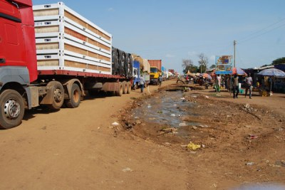 Trucks loaded with goods queue up for clearance at a Uganda-South Sudan border post.
