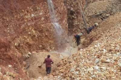 Men mine gold in Bihanga Sub-county, Buhweju District.