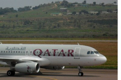 A Qatar Airways plane lands at Entebbe International Airport recently.