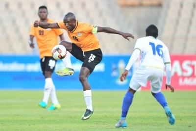 Donashano Malama of Zambia challenged by Yahya Ramadhani of Tanzania during 2017 Cosafa Castle Cup match between Zambia and Tanzania at Moruleng Stadium in Rustenburg on 05 July 2017.