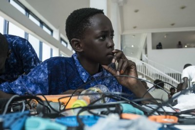 Aboubacar Savage, 14, from Gambia looks at a computer at the 2017 Pan-African Robotics Competition in Dakar, Senegal.