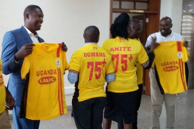 Ruling party MPs dressed in T-shirts showing support for the lifting of the age limit.