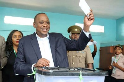 President Uhuru Kenyatta casts his ballot at Mutomo Primary School polling station in Kiambu County on October 26, 2017 during the presidential election.