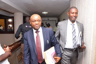 Raphael Magyezi, left, with one of his seconders Moses Balyeku storms out of the first hearing on the age limit bill.