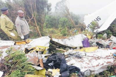Security officers inspect the remains of aircraft owned by Coastal Aviation that crashed at Empakaai Crater near Ngorongoro Crater in Arusha Region on Wednesday.