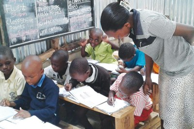 A teacher attends to learners (file photo).