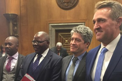 From left Zimbabwe opposition leaders Nelson Chamisa, Tendai Biti, U.S. Senators Jeff Flake and Author Peter Godwin.