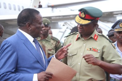 President Emmerson Mnangagwa chats with Zimbabwe Defence Forces Commander General Philip Valerio Sibanda.