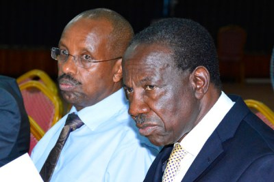 Secretary to the Treasury Keith Muhakanizi, left, and Finance Minister Matia Kasaija appear before Parliament's Public Accounts Committee last year.