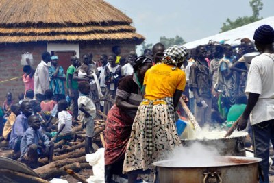 Refugees prepare a meal in Pagirinya Settlement in Adjumani District recently.