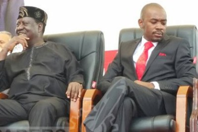MDC-T acting president Nelson Chamisa, right, sits next to Kenya's National Super Alliance (NASA) leader Raila Odinga in Buhera.