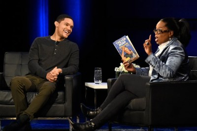 Trevor Noah being interviewed by Oprah Winfrey as part of her SuperSoul Conversations live show.