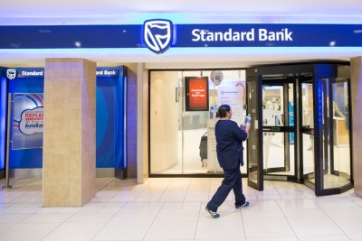 A customer enters a Standard Bank branch (file photo).