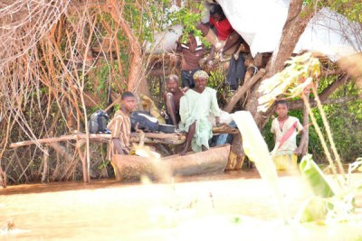 A family marooned by floods seeks refuge on trees in Tana Delta on April 22, 2018 as they wait to be evacuated.
