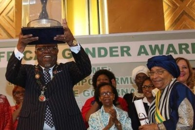 Namibian President Hage Geingob receives the African Gender Award from the 'Gender Is My Agenda Campaign', alongside the previous recipient, former Liberian President Ellen Johnson Sirleaf (right). Between them is Joyce Mends-Cole, a former senior UN refuge women's coordinator.
