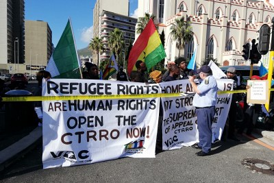 Refugees marched outside Parliament in Cape Town on International Refugee Day.