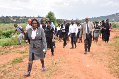 Justice Catherine Bamugemereire and other members of the land probe commission inspect a wetland in Luzira, Kampala, on June 13.