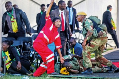 Medics attend to people injured in an explosion during a Zanu-PF rally in Bulawayo.