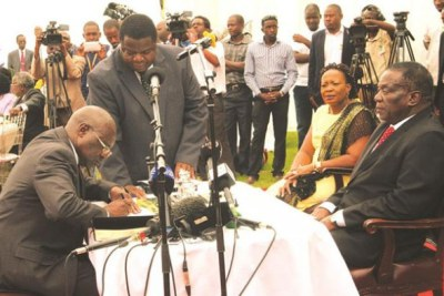 President Emmerson Mnangagwa swears in Advocate Ray Hemington Goba as substantive Prosecutor-General, while flanked by First Lady Auxillia Mnangagwa in December 2017. (file photo).