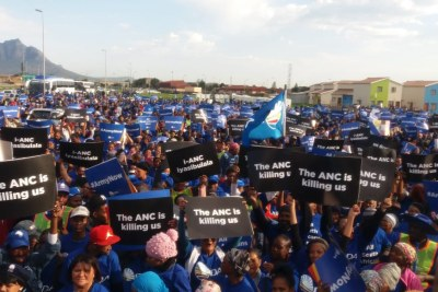 Democratic Alliance supporters bear signs saying 'The ANC is Killing Us' at the #SendTheArmyNow march in Cape Town.