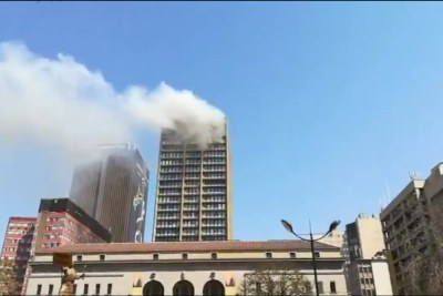 A blaze on the upper floors of a government building in the Johannesburg CBD where a firefighter fell to his death.