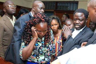 Sharon Atieno's mother Melida Auma (centre) together with family lawyer Peter Kaluma (right) at Milimani court in Nairobi on September 25, 2018.