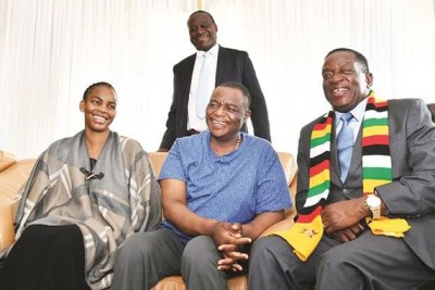 President Emmerson Mnangagwa speaks to Vice President Constantino Chiwenga and his wife Marry in Harare. Chiwenga had been in South Africa for treatment.