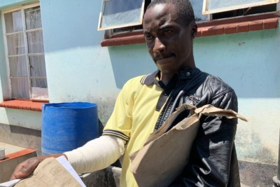 Adrian Munjere, who sustained fractures on his right hand during post-election clashes between security forces and protesters Aug. 1, displays his doctor's report.