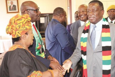 President Emmerson Mnangagwa greets David Parirenyatwa and Cleveria Chizema on arrival at a Politburo meeting in Harare on October 25, 2018.