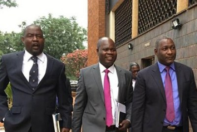 Supa Mandiwanzira, right, arrives at court on Wednesday with his lawyers.