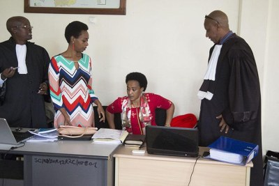Diane Rwigara and her mother Adeline Rwigara with their lawyers in a Kigali courtroom on November 7, 2018.