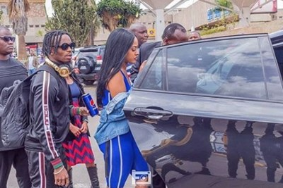 Diamond Platnumz and his girlfriend, Tanasha Donna Oketch board a vehicle at the Jomo Kenyatta International Airport on December 01, 2018.