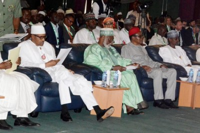 From left: Former Head of State Yakubu Gowon; President Muhammadu Buhari; former Head of State Abdulsalami Abubakar; former Chief of General Staff retired Commodore Ebitu Ukiwe; FCT Minister Mohammed Bello; and Bishop Matthew Hassan Kukah, at the signing of a peace accord by presidential candidates organized by the National Peace Committee in Abuja.