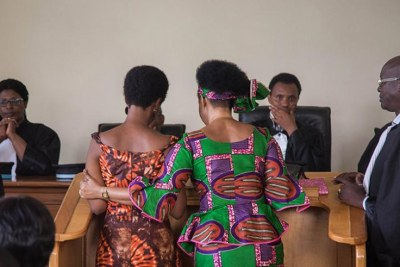 Diane Rwigara and her mother Adeline Rwigara together with their lawyers at the High Court.