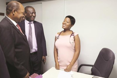Health and Child Care Minister Dr Obadiah Moyo and his deputy Dr John Mangwiro speak to Dr Matavata who resumed work yesterday at the Parirenyatwa Group of Hospitals.