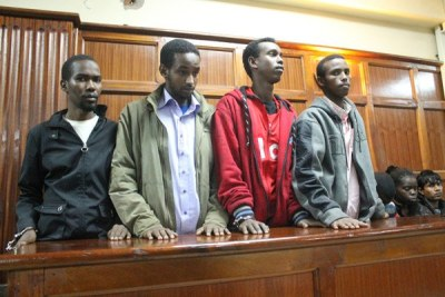 The four suspects charged over the Westgate terror attack. One has been set free for lack of sufficient evidence.