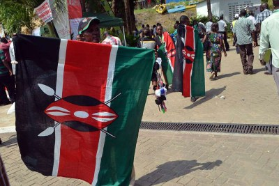 Citizens holding Kenyan flag (file photo).
