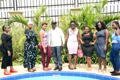 State Minister for Tourism Mr Godfrey Kiwanda with Ugandan models at the launch of 'Miss Curvy Uganda' at a Kampala hotel on February 5, 2019.