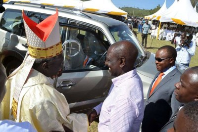 Archbishop Phillip Anyolo receives a Mitsubishi Pajero from the Deputy President William Ruto at Uzima University Grounds in Kisumu on January 12, 2019.