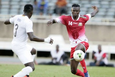 Harambee Stars striker Micheal Olunga (right) under pressure from Ghana's Nicholas Opoku during an Africa Cup of Nations qualifier match at Moi International Sports Centre, Kasarani (file photo).