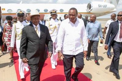 President Uhuru Kenyatta receives his Ugandan counterpart Yoweri Kaguta Museveni at the Moi International Airport in Mombasa.