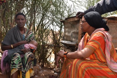 Fatima, who overcame pregnancy complications, chats to community health worker Dahabo Adi Galgallo in Moyale.