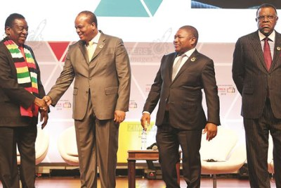 Zimbabwean President Emmerson Mnangagwa, left, greets King Mswati III of eSwatini, while Mozambican and Namibian Presidents Filipe Nyusi and Hage Geingob, third and fourth from left, look on at the 12th edition of the US-Africa Business Summit in Mozambique.
