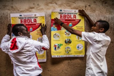 Students put up Information posters about Ebola.